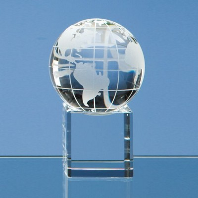 6CM OPTICAL GLASS GLOBE PAPERWEIGHT ON CLEAR TRANSPARENT BASE.