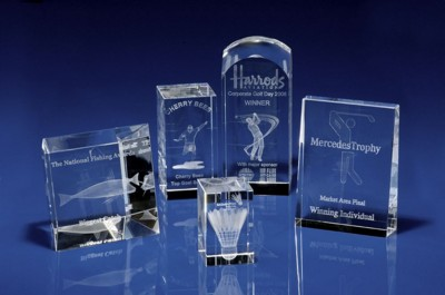 CRYSTAL GLASS SPORTS PAPERWEIGHT OR AWARD.