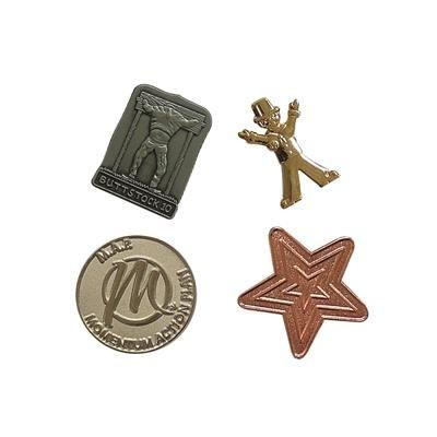 METAL RELIEF PIN BADGE.