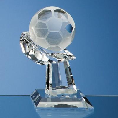 6CM OPTICAL GLASS FOOTBALL MOUNTED ON HAND AWARD.