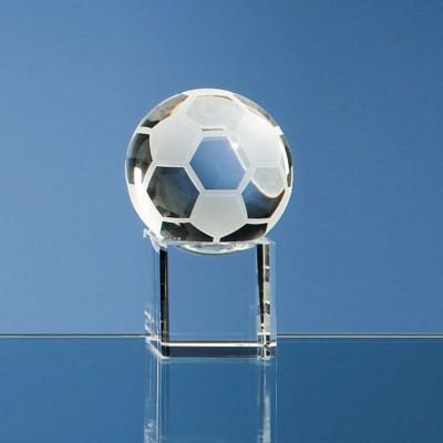 5CM OPTICAL GLASS FOOTBALL ON CLEAR TRANSPARENT BASE AWARD.