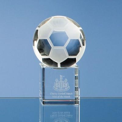 6CM OPTICAL GLASS FOOTBALL ON CLEAR TRANSPARENT BASE AWARD.