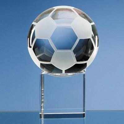 10CM OPTICAL GLASS FOOTBALL ON CLEAR TRANSPARENT BASE AWARD.