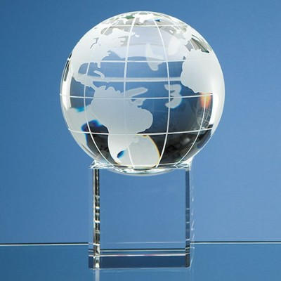 10CM OPTICAL GLASS GLOBE PAPERWEIGHT ON CLEAR TRANSPARENT BASE.