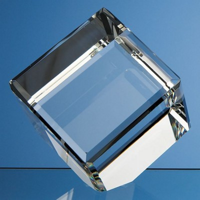 10CM OPTICAL GLASS BEVEL EDGE CUBE PAPERWEIGHT.