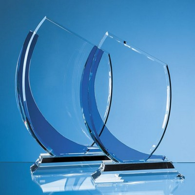 23CM OPTICAL CRYSTAL SLOPE AWARD WITH SAPPHIRE BLUE CURVE.