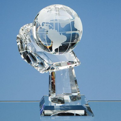 Picture of 8CM OPTICAL CRYSTAL GLOBE ON MOUNTED HAND AWARD